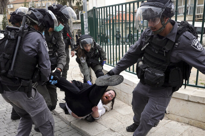 File - In this Monday, March 30, 2020 file photo, Israeli police arrest an Ultra Orthodox Jew during protest against government's measures to stop the spread of the coronavirus in the orthodox neighborhood of Mea Shearim in Jerusalem. (AP Photo/Mahmoud Illean, File)