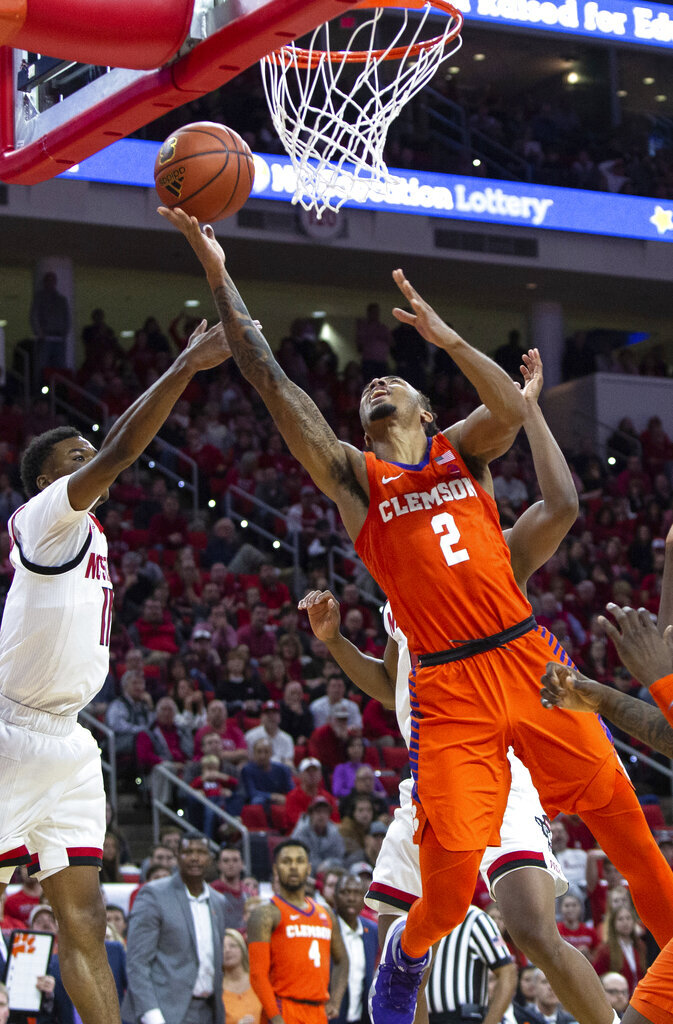Clemson's Marcquise Reed (2) attempts a shot in the lane during an NCAA college basketball game against North Carolina State in Raleigh, N.C., Saturday, Jan. 26, 2019. (AP Photo/Ben McKeown)