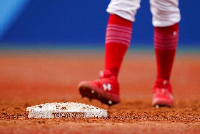 Dominican Republic's Melky Cabrera takes a lead off first base during a baseball game against Mexico at Yokohama Baseball Stadium during the 2020 Summer Olympics, Friday, July 30, 2021, in Yokohama, Japan. (AP Photo/Matt Slocum)
