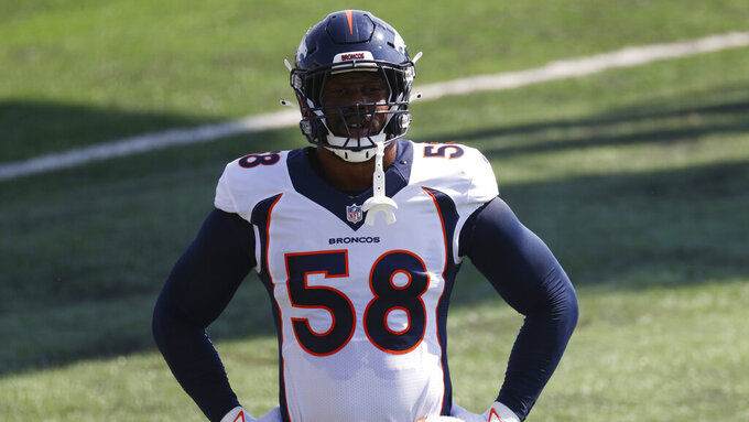 Denver Broncos linebacker Von Miller (58) takes part in drills during an NFL football practice Tuesday, Aug. 18, 2020, at the team's headquarter in Englewood, Colo. The superstar linebacker is so eager to end four years of frustration that he reshaped his body and his mindset in the offseason. (AP Photo/David Zalubowski)