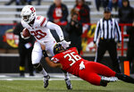 Rutgers punt returner Avery Young, left, tries to break free from Maryland long snapper Matt Oliveira in the first half of an NCAA college football game, Saturday, Oct. 13, 2018, in College Park, Md. (AP Photo/Patrick Semansky)