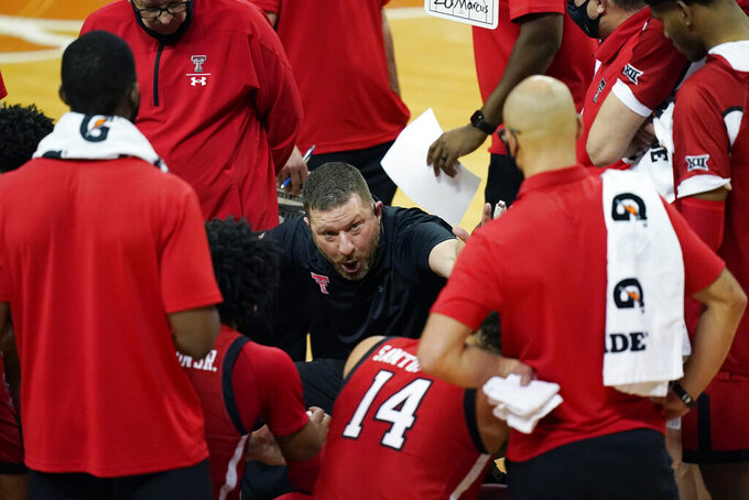 Texas Tech coach Chris Beard, center, talks with the team during the first half of an NCAA college basketball game against Texas, Wednesday, Jan. 13, 2021, in Austin, Texas. (AP Photo/Eric Gay)