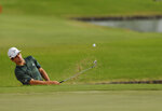 Joaquin Niemann, of Chile, hits from a bunker onto the third green during the final round of the Sony Open golf tournament Sunday, Jan. 17, 2021, at Waialae Country Club in Honolulu. (Jamm Aquino/Honolulu Star-Advertiser via AP)