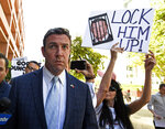 FILE - In this July 1, 2019, file photo, U.S. Rep. Duncan D. Hunter, R-Calif., leaves federal court after a hearing in San Diego. Hunter has indicated he's on his way out of office after pleading guilty to a corruption charge, a break for California's beleaguered GOP that increases the chances the party keeps one of its few remaining House seats in the heavily Democratic state. But Hunter's pending departure also comes with a measure of uncertainty. There is no clear Republican favorite to succeed him in the San Diego County district, setting the stage for several months of party infighting in a race that could turn on local political loyalties or the potential involvement of President Donald Trump. (AP Photo/Denis Poroy, File)