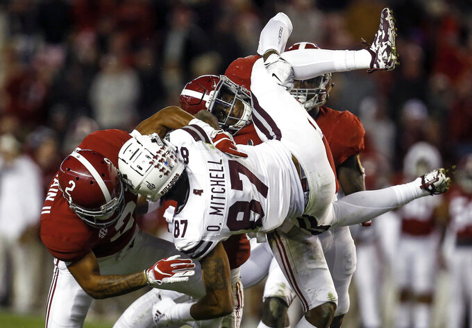 Mississippi State wide receiver Osirus Mitchell (87) is tackled by Alabama defensive back Patrick Surtain II (2) and linebacker Mack Wilson (30) during the second half of an NCAA college football game, Saturday, Nov. 10, 2018, in Tuscaloosa, Ala. (AP Photo/Butch Dill)