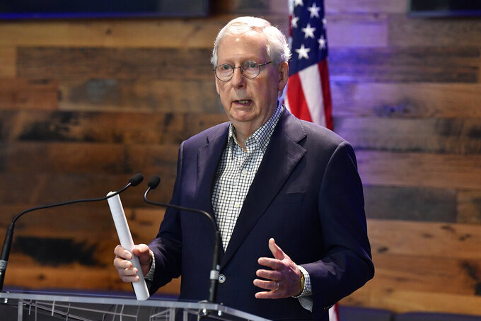 Senate Minority Leader Mitch McConnell, R-Ky., addresses the media at a COVID vaccination site at Kroger Field in Lexington, Ky., Monday, April 5, 2021. (AP Photo/Timothy D. Easley)