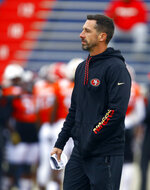 South head coach Kyle Shanahan of the San Francisco 49ers walks the field during practice for Saturday's Senior Bowl college football game, Tuesday, Jan. 22, 2019, in Mobile, Ala. (AP Photo/Butch Dill)