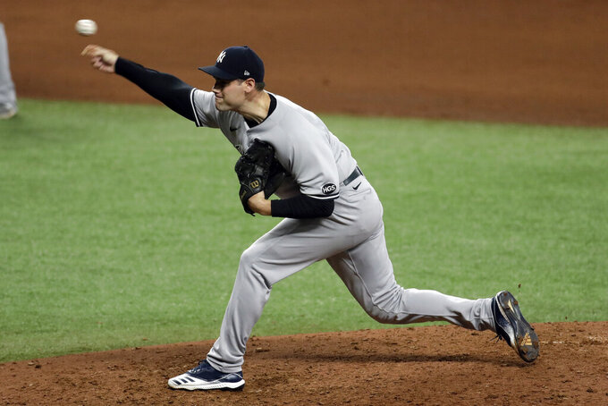 New York Yankees relief pitcher Adam Ottavino delivers to the Tampa Bay Rays during the eighth inning of a baseball game Friday, Aug. 7, 2020, in St. Petersburg, Fla. (AP Photo/Chris O'Meara)