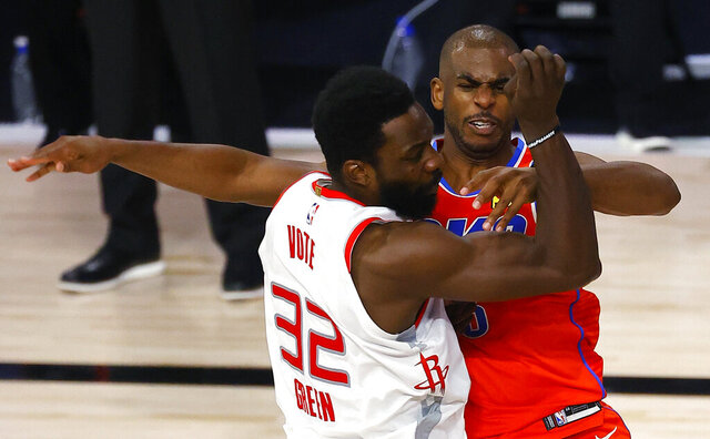 Oklahoma City Thunder's Chris Paul, right, tangles with Houston Rockets' Jeff Green during the third quarter of Game 3 of an NBA basketball first-round playoff series, Saturday, Aug. 22, 2020, in Lake Buena Vista, Fla. (Mike Ehrmann/Pool Photo via AP)