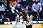 Purdue forward Trevion Williams (50) goes up for a dunk in front of Michigan State forward Thomas Kithier (15) during the second half of an NCAA college basketball game in West Lafayette, Ind., Tuesday, Feb. 16, 2021. (AP Photo/Michael Conroy)