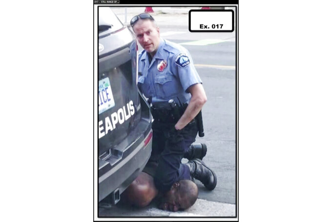 """In this image from video provided by Darnella Frazier, Minneapolis Police Officer Derek Chauvin kneels on the neck of George Floyd in Minneapolis on Monday, May 25, 2020. The former Minneapolis police officer charged with killing Floyd went on trial Monday, March 29, 2021. For jurors at Chauvin's murder trial, the enduring image of the defendant is his impassive expression as he gazed at the teenager filming his knee pinning Floyd's neck – what the girl called his """"cold"""" and """"heartless"""" stare. (Darnella Frazier via AP)"""