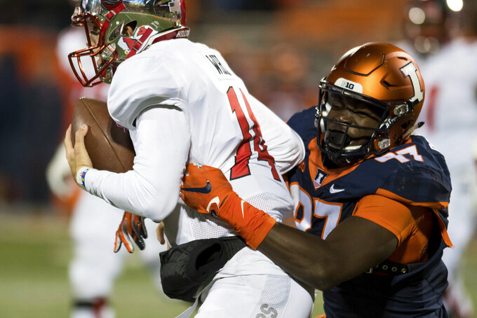 FILE - In this Sept. 9, 2017, file photo, Illinois defensive lineman Bobby Roundtree (97) sacks Western Kentucky quarterback Mike White, left, during the fourth quarter of an NCAA college football game in Champaign, Ill. Former Illinois football star Roundtree, who was left paralyzed by a spinal cord injury in swimming accident in 2019, died Friday, July 16, 2021. He was 23. (AP Photo/Bradley Leeb, File)