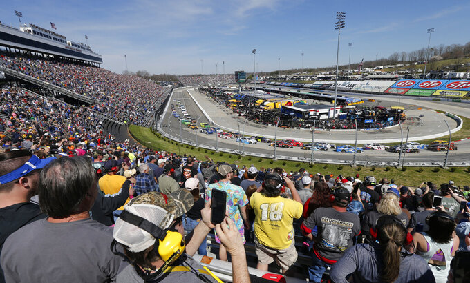 Race fans watch the start of the NASCAR Cup Series auto race at the Martinsville Speedway in Martinsville, Va., Sunday, March 24, 2019. (AP Photo/Steve Helber)