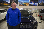 """Howard Hakes, chairman of the American International Automobile Dealers Association, poses with a 2019 Toyota RAV4 manufactured in Japan at his dealership Thursday, Feb. 14, 2019, in Industry, Calif. If 25 percent tariffs are fully assessed against imported parts and vehicles, and they include Canada and Mexico, the price of imported vehicles would rise more than 17 percent, or around $5,000 each, according to forecasts from IHS Markit. """"I think it would be harmful to the whole economy,"""" said Hakes. (AP Photo/Jae C. Hong)"""