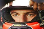 Red Bull driver Max Verstappen, of Netherlands, looks out from inside his car during the second free practice at the Interlagos race track in Sao Paulo, Brazil, Friday, Nov. 9, 2018. (AP Photo/Nelson Antoine)