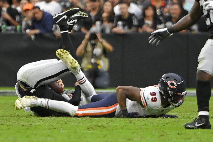 Chicago Bears linebacker Trevis Gipson (99) sacks Las Vegas Raiders quarterback Derek Carr (4) during the second half of an NFL football game, Sunday, Oct. 10, 2021, in Las Vegas. (AP Photo/David Becker)