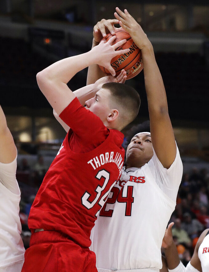 Rutgers guard/forward Ron Harper Jr., right, steals the ball from Nebraska guard Thorir Thorbjarnarson during the first half of an NCAA college basketball game in the first round of the Big Ten Conference tournament in Chicago, Wednesday, March 13, 2019. (AP Photo/Nam Y. Huh)