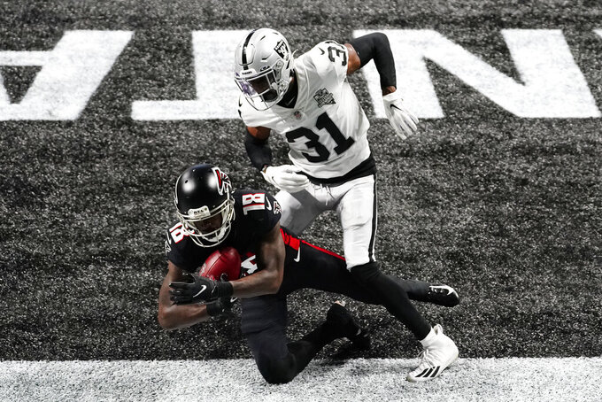 Atlanta Falcons wide receiver Calvin Ridley (18) scores a touchdown against Las Vegas Raiders cornerback Isaiah Johnson (31) during the first half of an NFL football game, Sunday, Nov. 29, 2020, in Atlanta. (AP Photo/Brynn Anderson)