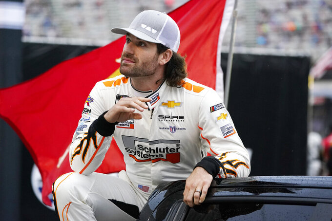 Corey LaJoie waves to fans before a NASCAR Cup Series auto race at Bristol Motor Speedway Saturday, Sept. 18, 2021, in Bristol, Tenn. (AP Photo/Mark Humphrey)