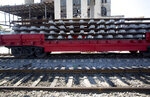 Rails and cross ties that need repai sit atop railroad flat car, in Havana, Cuba, Wednesday, May 22, 2019. The government is busy restoring and repairing rail lines throughout the island, some with rusting rails overgrown with weeds or buried under drifting dirt. (AP Photo/Ismael Francisco)