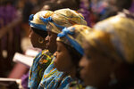 Women pray during a Mass celebrated by Pope Francis for the Congolese Catholic community of Rome, in St. Peter's Basilica at the Vatican Sunday, Dec. 1, 2019. (AP Photo/Alessandra Tarantino)