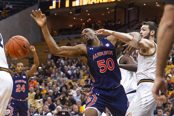Missouri's Reed Nikko, right, and Auburn's Austin Wiley watch a rebound get away during the first half of an NCAA college basketball game Saturday, Feb. 15, 2020, in Columbia, Mo. Missouri won 85-73. (AP Photo/L.G. Patterson)