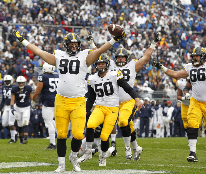 Iowa's Sam Brincks (90) celebrates after catching a touchdown pass against Penn State during the first half of an NCAA college football game in State College, Pa., Saturday, Oct. 27, 2018. (AP Photo/Chris Knight)
