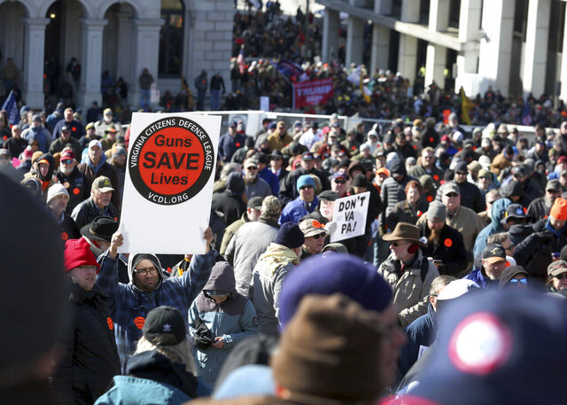 Gun-rights supporters pack the hill on Capitol Square as speakers talk in Richmond, Va., Monday Jan. 20, 2020. Gun-rights activists and other groups are descending on Virginia's capital city of Richmond to protest plans by the state's Democratic leadership to pass gun-control legislation.(Rob Ostermaier/The Virginian-Pilot via AP)