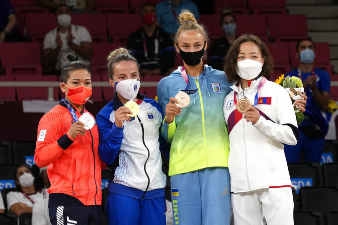 From left, silver medalist Funa Tonaki of Japan, gold medalist Distria Krasniqi of Kosovo, and bronze medalists Daria Bilodid of Ukraine and Urantsetseg Munkhbat of Mongolia pose with their medals for women's -48kg judo at the 2020 Summer Olympics, Saturday, July 24, 2021, in Tokyo, Japan. (AP Photo/Vincent Thian)