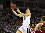 Virginia's Kyle Guy (5) drives for a layup during the second half of a second round men's college basketball game against Oklahoma in the NCAA Tournament in Columbia, S.C. Sunday, March 24, 2019. (AP Photo/Richard Shiro)