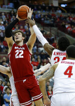 Wisconsin forward Ethan Happ, left, goes up for a shot against Ohio State forward Andre Wesson, center, and guard Duane Washington during the first half of an NCAA college basketball game in Columbus, Ohio, Sunday, March 10, 2019. (AP Photo/Paul Vernon)