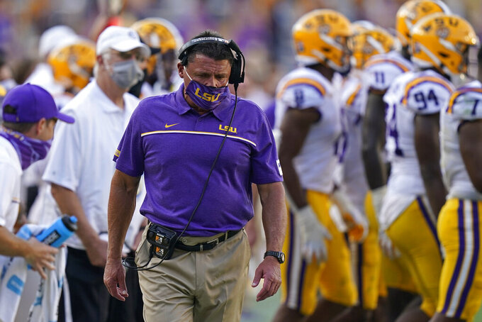LSU head coach Ed Orgeron walks on the sideline in the second half an NCAA college football game against Mississippi State in Baton Rouge, La., Saturday, Sept. 26, 2020. Mississippi State won 44-34. (AP Photo/Gerald Herbert)