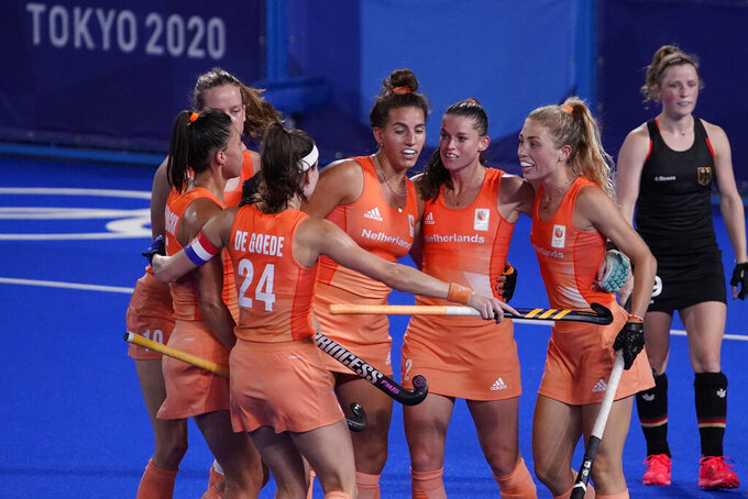 Netherlands' Frederique Matla, center left, celebrates with her teammates after scoring during a women's field hockey match against Germany at the 2020 Summer Olympics, Saturday, July 31, 2021, in Tokyo, Japan. (AP Photo/John Locher)