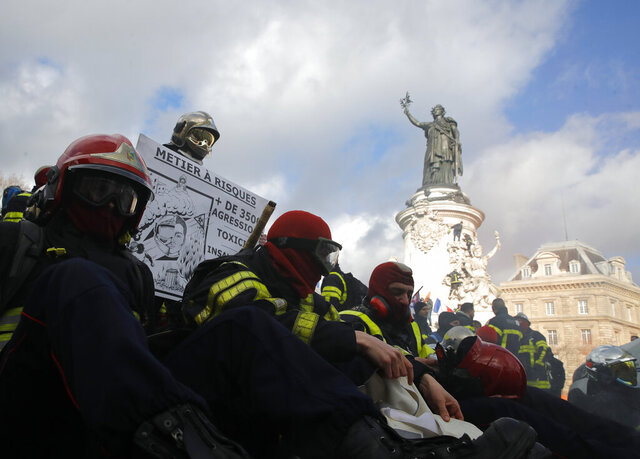 Firefighters gather for a demonstration Tuesday, Jan. 28, 2020 in Paris to demand a better pay and working conditions. (AP Photo/Christophe Ena)