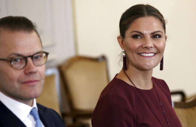 Sweden's Crown Princess Victoria, right, smiles during her meeting with members of the tripartite Presidency of Bosnia and Herzegovina, in Sarajevo, Bosnia-Herzegovina, Wednesday, Nov. 6, 2019. Swedish Crown Princess Victoria has urged Bosnian leaders to commit to tackling the climate change and environmental pollution, saying it was one of the key challenges they will have to address if they want to bring their country into the European Union. (AP Photo/Kemal Softic)