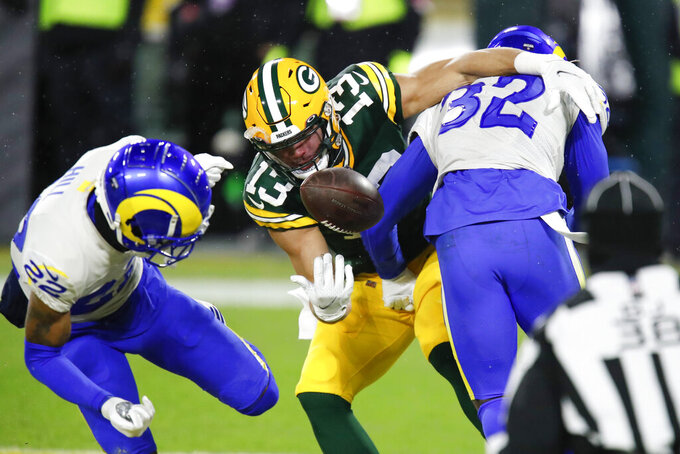Los Angeles Rams strong safety Jordan Fuller, right, and cornerback Troy Hill, left, break up a pass intended for Green Bay Packers wide receiver Allen Lazard during the first half of an NFL divisional playoff football game Saturday, Jan. 16, 2021, in Green Bay, Wis. (AP Photo/Matt Ludtke)
