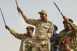 Gen. Mohammed Hamdan Dagalo, the deputy head of the military council, speaks during a military-backed tribe's rally, in the Nile River State, Sudan, Saturday, July 13, 2019.  (AP Photo/Mahmoud Hjaj)