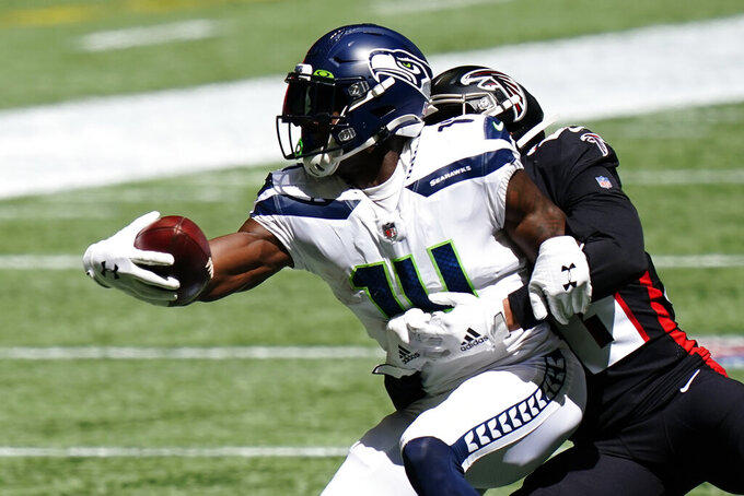 Seattle Seahawks wide receiver DK Metcalf (14) makes a catch against the Atlanta Falcons during the second half of an NFL football game, Sunday, Sept. 13, 2020, in Atlanta. (AP Photo/Brynn Anderson)