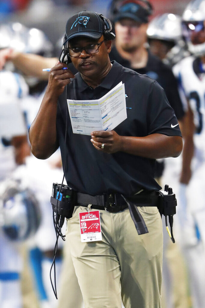Carolina Panthers interim head coach Perry Fewell speaks to coaches during the first half of an NFL football game against the Carolina Panthers, Sunday, Dec. 8, 2019, in Atlanta. (AP Photo/John Bazemore)