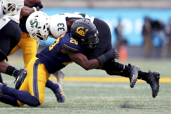 Sacramento State running back Elijah Dotson (33) is tackled by California cornerback Josh Drayden during the first half of an NCAA college football game on Saturday, Sept. 18, 2021, in Berkeley, Calif. (AP Photo/Jed Jacobsohn)