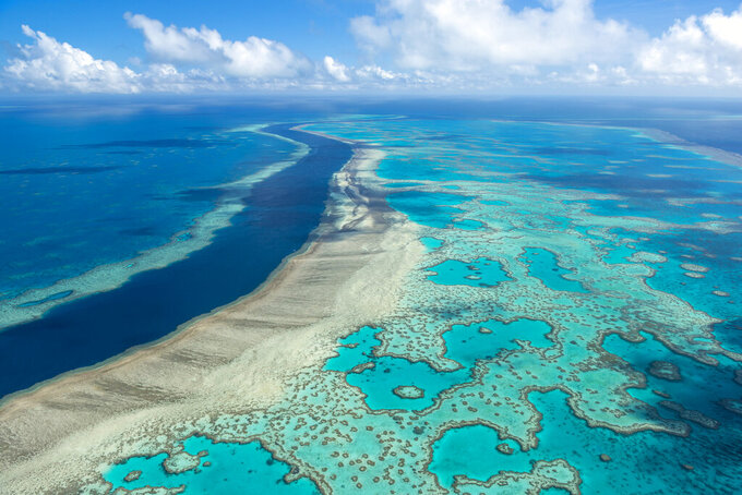 In this undated photo provided by the Great Barrier Reef Marine Park Authority, the Great Barrier Reef near the Whitsunday, Australia, region is viewed from the air. Australia on Friday, July 23, 2021, garnered enough international support to defer for two years an attempt by the United Nations' cultural organization to downgrade the Great Barrier Reef's World Heritage status. (Jumbo Aerial Photography/Great Barrier Reef Marine Park Authority via AP)