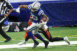 Indianapolis Colts' Marcus Johnson (83) is tackled by Cincinnati Bengals' Vonn Bell (24) during the first half of an NFL football game, Sunday, Oct. 18, 2020, in Indianapolis. (AP Photo/AJ Mast)