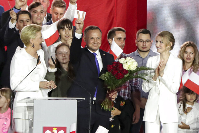 FILE - In this Sunday, July 12, 2020 file photo, incumbent President Andrzej Duda flashes a victory sign in Pultusk, Poland. The Supreme Court of Poland has upheld the reelection of President Andrzej Duda after deciding that complaints about the validity of the country's presidential election were insufficient to void the results. The ruling paves the way for Duda to take the oath of office before both chambers of parliament on Thursday Aug. 6, 2020. (AP Photo/Czarek Sokolowski, File)