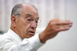 In this June 30, 2021, photo Sen. Chuck Grassley, R-Iowa, speaks during a meeting with employees at Professional Computer Solution, in Denison, Iowa. (AP Photo/Charlie Neibergall)