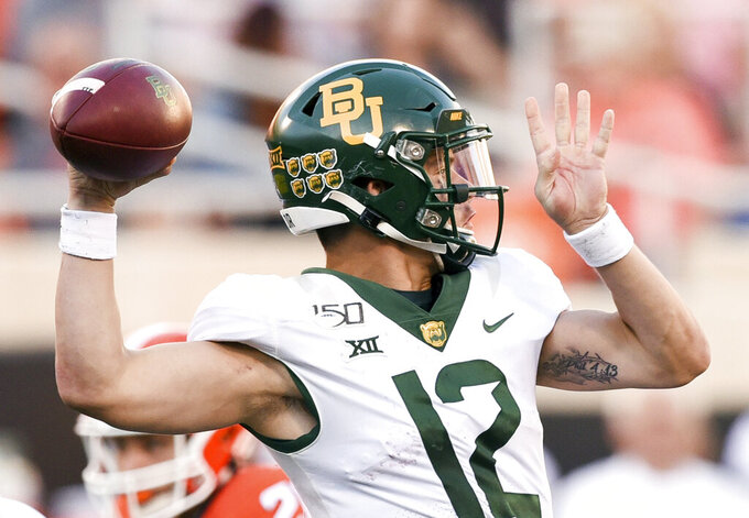 Baylor quarterback Charlie Brewer prepares to throw a pass during the first half of an NCAA college football game against Oklahoma State in Stillwater, Okla., Saturday, Oct. 19, 2019. (AP Photo/Brody Schmidt)