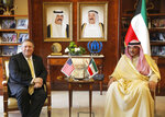 U.S. Secretary of State Mike Pompeo meets with Kuwait's Foreign Minister Sheikh Sabah Al-Khalid Al-Sabah in Kuwait, Wednesday, March 20, 2019. (Jim Young/Pool Photo via AP)