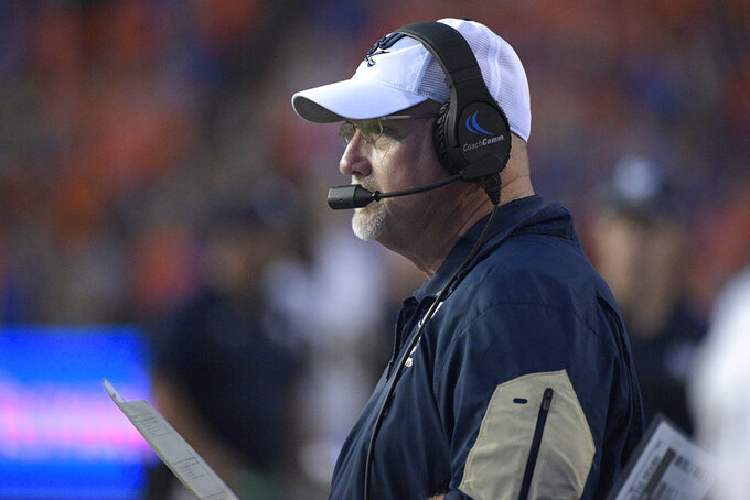 Charleston Southern head coach Mark Tucker watches from the sideline during the first half of an NCAA college football game against Florida Saturday, Sept. 1, 2018, in Gainesville, Fla. (AP Photo/Phelan M. Ebenhack)