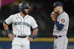 Seattle Mariners' Abraham Toro, left, talks with a former teammate, Houston Astros shortstop Carlos Correa, right, while on second base during the fourth inning of a baseball game Tuesday, Aug. 31, 2021, in Seattle. (AP Photo/Ted S. Warren)