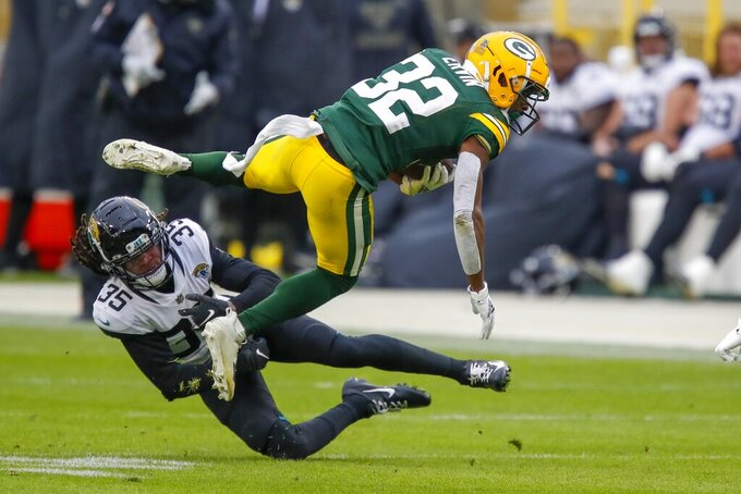 Jacksonville Jaguars' Sidney Jones stops Green Bay Packers' Tyler Ervin during the first half of an NFL football game Sunday, Nov. 15, 2020, in Green Bay, Wis. (AP Photo/Matt Ludtke)