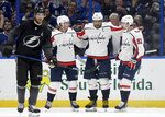 Tampa Bay Lightning defenseman Victor Hedman (77) skates away as Washington Capitals Nicklas Backstrom (19), Alex Ovechkin (8) and Evgeny Kuznetsov (92) celebrate Ovechkin's goal during the second period of an NHL hockey game Saturday, March 16, 2019, in Tampa, Fla. (AP Photo/Jason Behnken)